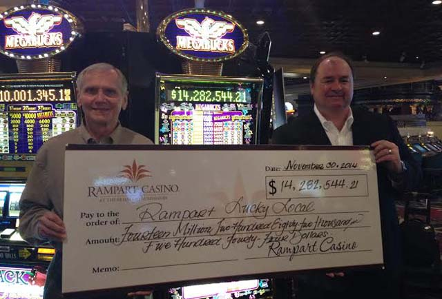 A lucky winner won  $14 million jackpot playing Megabucks at Rampart Casino. Seen here posing with his check. (Image: The resort at Summerlin)